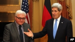 German Foreign Minister Frank-Walter Steinmeier , left, and U.S. Secretary of State John Kerry, meet during closed-door nuclear talks with Iran in Vienna, Nov. 22, 2014.