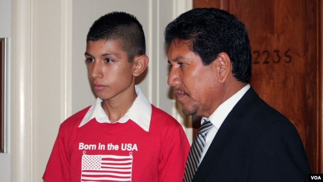 Saul Arellano, left, the son of a Mexican woman deported from the U.S., stands with an immigration activist at a meeting of the Congressional Hispanic Congress in Washington, DC on June 5, 2013. (Photo by Mitzi Macias)