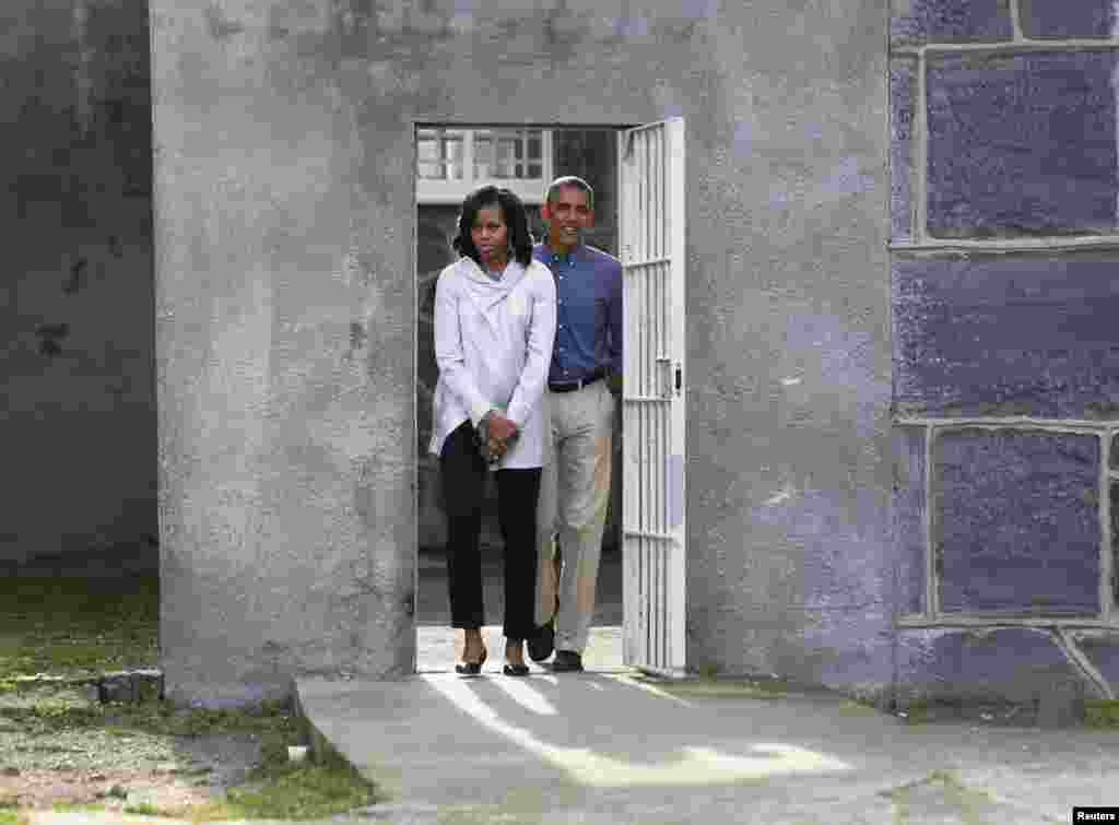 U.S. President Barack Obama and First Lady Michelle Obama tour the cell block on Robben Island where former South African President Nelson Mandela was held captive near Cape Town.