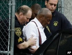 FILE - Bill Cosby departs after his sentencing hearing at the Montgomery County Courthouse, Sept. 25, 2018, in Norristown, Pennsylvania.