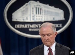 FILE - Attorney General Jeff Sessions pauses during a news conference at the Justice Department in Washington, March 2, 2017.