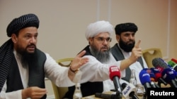 Members of Taliban political office attend a news conference in Moscow