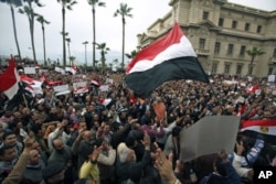 FILE - Protesters chant anti-government slogans during mass demonstrations against Egypt's President Hosni Mubarak, in Alexandria, Egypt, Feb. 4, 2011.