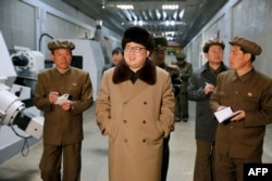 FILE - This undated photo released by North Korea's official Korean Central News Agency (KCNA) on April 2, 2016 shows North Korean leader Kim Jong-Un (C) at the Tonghungsan Machine Plant.