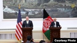 Afghan President Ashraf Ghani (right), and U.S. Secretary of State Mike Pompeo speak at a joint press conference at the Presidential Palace, in Kabul, Afghanistan, July 9, 2018.