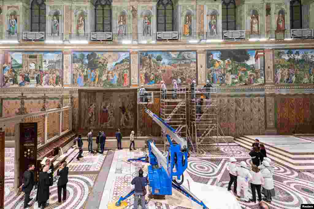 A tapestry designed by Renaissance artist Raphael is installed on a lower wall of the Sistine Chapel at the Vatican as part of celebrations marking the 500th anniversary of his death in this handout photo released.