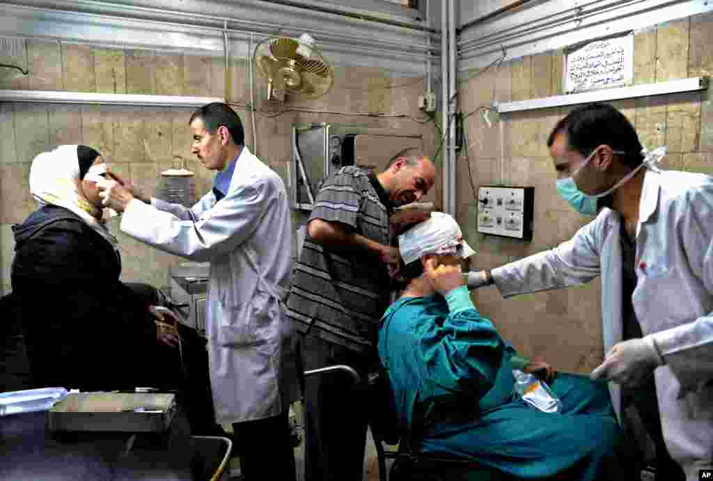 Syrian doctors treat citizens who were injured in an explosion in the central district of Marjeh, Damascus, Syria, April 30, 2013.