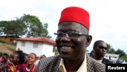 FILE - Prince Johnson, who at the time was himself a presidential candidate, campaigns in the village of Demeh in Bomi County, Liberia, Sept. 14, 2011. The former warlord has endorsed George Manneh Weah in next month's presidential runoff.
