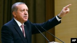 Turkish President Recep Tayyip Erdogan speaks during an event for foreign investors in Ankara, Aug. 2, 2016. He again blasted unnamed Western countries that he said supported an attempted coup July 15.