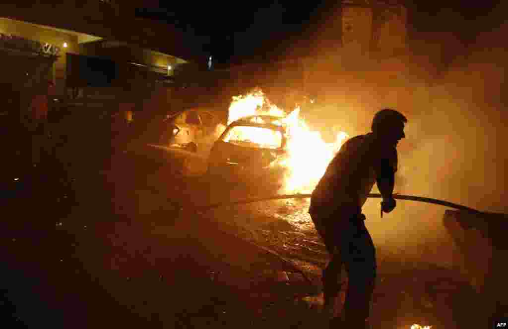 Lebanese civil defense firefighters put out a fire at the site of a car bomb attack in the mainly Shi'ite populated Shayyah neighborhood of a Beirut southern suburb.