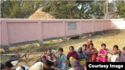 Self-Help Groups (i.e. small-scale lending and savings groups or microcredit groups) in villages in Bihar, India taken during a field visit. They are seen conducting their weekly meeting and collecting savings and repayments.