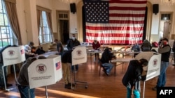 Voters cast their ballots at the old Stone School, used as a polling station, on election day in Hillsboro, Virginia on November 3, 2020.