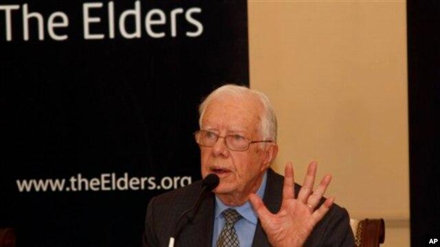 အေမရိကန္သမၼတေဟာင္း Jimmy Carter ၊ ၂၀၁၃ စက္တင္ဘာလ ရန္ကုန္ၿမိဳ႕တြင္ ေရာက္ရွိစဥ္။