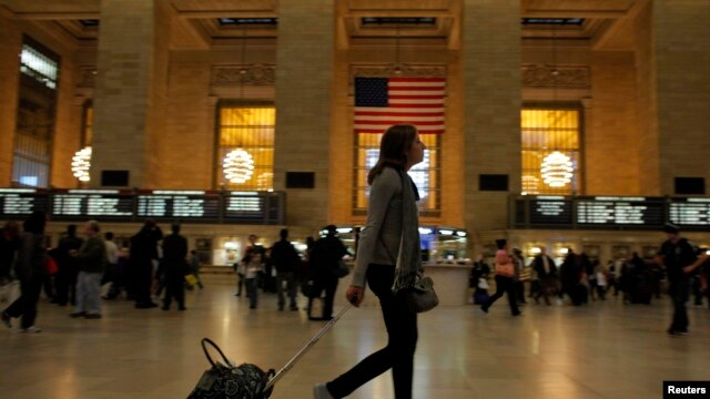 A woman pulls her luggage at Grand Central Station while Hurricane Sandy approaches New York, October 28, 2012.