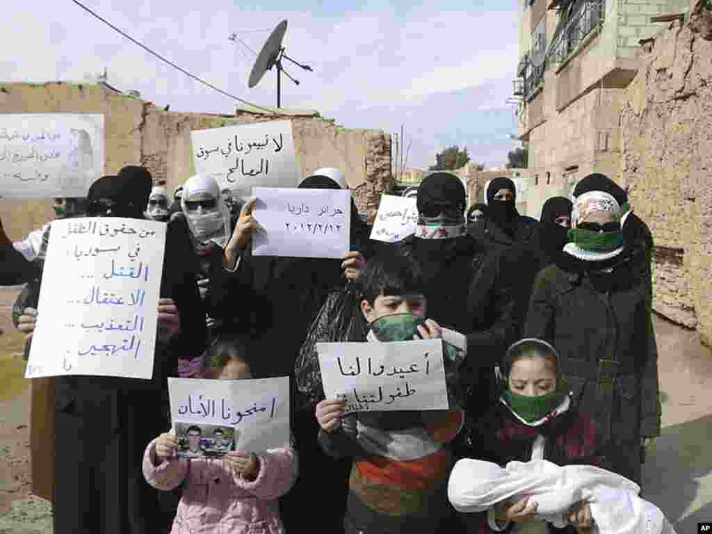 Demonstrators gather during a protest against President Bashar al-Assad in Daria, near Damascus, February 12, 2012. (Reuters)