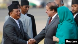 FILE - Nepali Deputy Prime Minister Prakash Man Singh (L) shakes hands with Pakistani Prime Minister Nawaz Sharif upon his arrival for the 18th South Asian Association for Regional Cooperation (SAARC) summit in Kathmandu, Nov. 25, 2014.