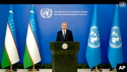 In this photo taken from video, Uzbekistan's President Shavkat Mirziyoyev remotely addresses the 76th session of the United Nations General Assembly in a pre-recorded message, Sept. 21, 2021 at U.N. headquarters. (UN Web TV via AP)