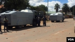 Police with water cannon vehicles outside the MDC-T headquarters in Bulawayo.