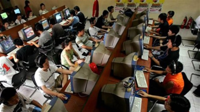 Chinese youths use computers at an Internet cafe in Beijing