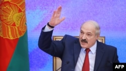 FILE - Belarus' President Alexander Lukashenko gestures during a press conference in Minsk, Jan. 29, 2015.