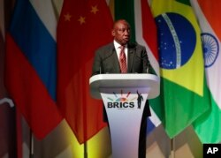South African President Cyril Ramaphosa speaks during his opening of the BRICS Summit in Johannesburg, July 25, 2018. The summit runs through Friday with various heads of BRICS attending.