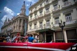 A vintage American car is parked in front of the Inglaterra hotel in Havana, Cuba, June 17, 2017.