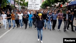 Protesters march as they demonstrate to blame the ruling AK Party (AKP) government for the mining disaster in Soma, a district in Turkey's western province of Manisa May 16, 2014. Turkish police fired water cannon and tear gas on Friday to disperse a crow