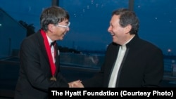 Toyo Ito, left, receives the 2013 Pritzker Architecture Prize from Thomas J. Pritzker, at ceremonies in Boston, May 29, 2013.