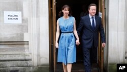 Britain's Prime Minister David Cameron and his wife Samantha leave after voting in the EU referendum in London, Thursday, June 23, 2016.