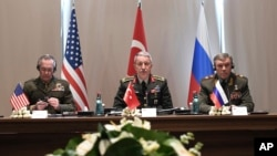 FILE - Turkey's Chief of Staff Gen. Hulusi Akar, center, U.S. Chairman of the Joint Chiefs of Staff Gen. Joseph Dunford, left, and Russia's Chief of Staff Gen. Valery Gerasimov attend a meeting in the Mediterranean coastal city of Antalya, Turkey, March 7, 2017.