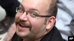 FILE - Jason Rezaian, an Iranian-American correspondent for the Washington Post, is shown in a 2013 photo.