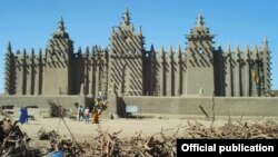 FILE - The Mosque of Djenné in Mali is considered the largest adobe structure in the world.