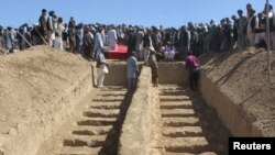 FILE - Graves are prepared for the burial of civilians killed by insurgents at Mirza Olang village, in Sar-e Pul province, Afghanistan, Aug. 16, 2017.