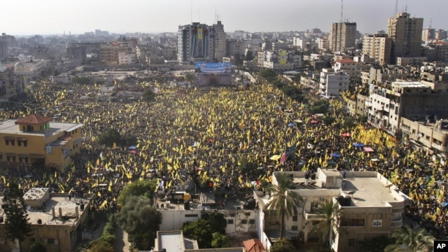 Tens of thousands of Palestinians marched Friday carrying yellow banners of Palestinian President Mahmoud Abbas' Fatah party during celebrations marking the 48th anniversary of the Fatah movement in Gaza City, January 4, 2013.