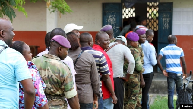 FILE - Military personnel vote at a polling station in Brazzaville, Congo, October 25, 2015.