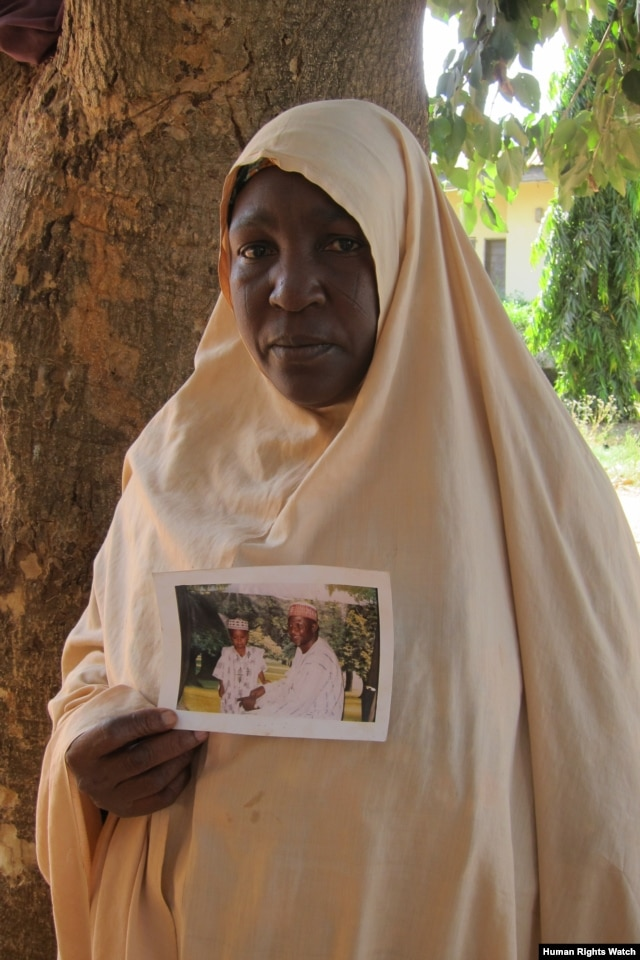 A Muslim woman, from the Hausa-Fulani ethnic group, holds up a photograph of her husband who was killed on April 19, 2011 in Zonkwa, Kaduna State. (Photo: © 2011 Eric Guttschuss/Human Rights Watch)