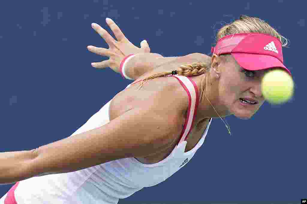 Kristina Mladenovic of France returns a shot to Varvara Gracheva of Russia during the second round of the U.S. Open tennis championships in New York.