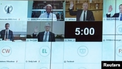 Amazon CEO Jeff Bezos, Facebook CEO Mark Zuckerberg, Google CEO Sundar Pichai and Apple CEO Tim Cook all raise their hands to be sworn in to testify remotely via videoconference during a U.S. House Judiciary Subcommittee on Antitrust, Commercial and Administrative Law hearing on