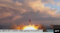 A TV grab taken Sept. 23, 2017, from Iranian Republic Islamic Broadcasting shows a Khoramshahr missile being launched from an undisclosed location, a day after the missile was first displayed at a military parade in Tehran. Iran said Sept. 23 that it had successfully tested the new medium-range missile in defiance of warnings from Washington that such activities were grounds for abandoning their nuclear deal.