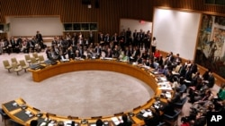 Member states vote to approve a resolution that will impose a no-fly zone over Libya during a meeting of the United Nations Security Council at U.N. headquarters, March 17, 2011
