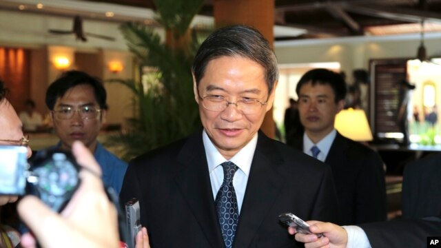 FILE - Zhang Zhijun, director of the Taiwan Affairs Office (TAO), is asked for comments by journalists after meeting with Taiwan's former Vice President Vincent Siew in Bali, Indonesia, Sunday, Oct. 6, 2013.