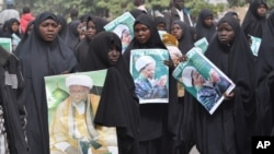FILE - Nigeria Shiite Muslims took to the streets to protest violence against them and demand the release of Shiite leader Ibraheem Zakzaky, in Kano, Nigeria, Dec. 21, 2015.