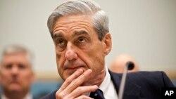FILE - Then-FBI Director Robert Mueller testifies on Capitol Hill in Washington, June 13, 2013.