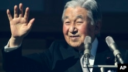 Japan's Emperor Akihito waves to well-wishers as he appears on the bullet-proofed balcony of the Imperial Palace in Tokyo, Dec. 23, 2017.