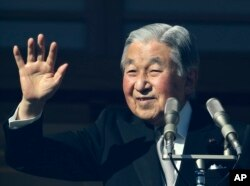 FILE - Japan's Emperor Akihito waves to well-wishers as he appears on the bullet-proofed balcony of the Imperial Palace in Tokyo, Dec. 23, 2017. Akihito marked his 84th birthday on Saturday with a pledge to fulfill his duties until the day of his abdication in 2019.
