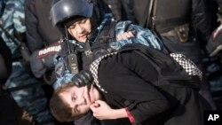 Police detain a protester in downtown Moscow, Russia, March 26, 2017.