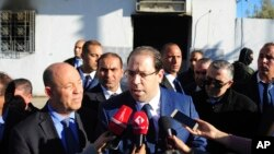 Tunisian Prime Minister Youssef Chahed speaks to reporters as he visits a sacked police station in El Battan, 35 kms west of Tunis, Jan. 10, 2018.