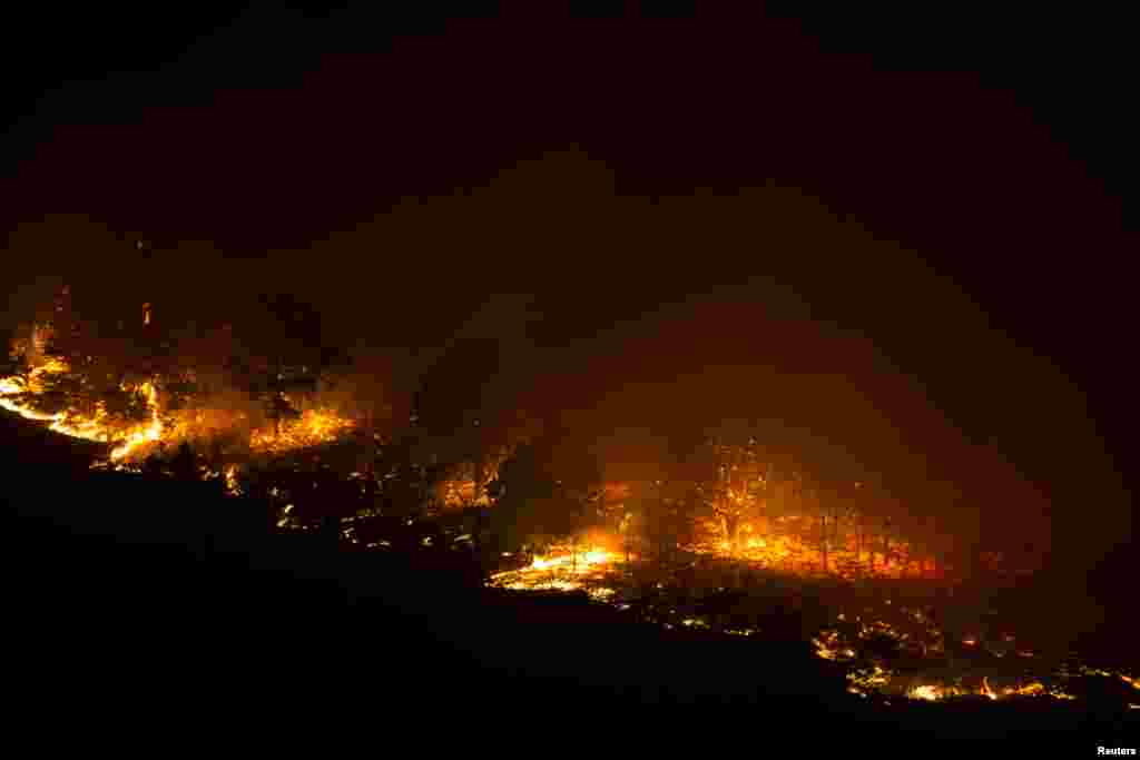 A forest fire burns out of control in Las Manchas, on the southwestern part of La Palma island, Spain.