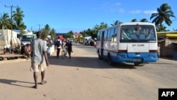 A bus drives along a street in Macomia, Cabo Delgado province, Mozambique, June 11, 2018. Cabo Delgado, expected to become the center of a natural gas industry after several promising discoveries, has seen a string of assaults on security forces and civilians since October.