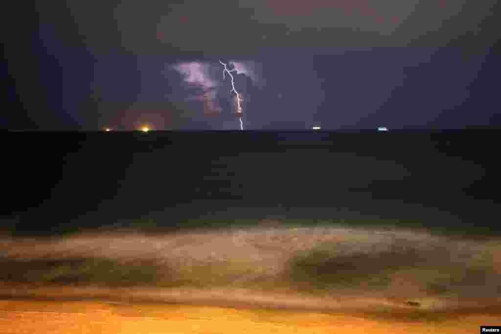 Lightning strikes over the Mediterranean Sea during a thunderstorm near the city of Ashkelon, Israel Nov. 14, 2018.